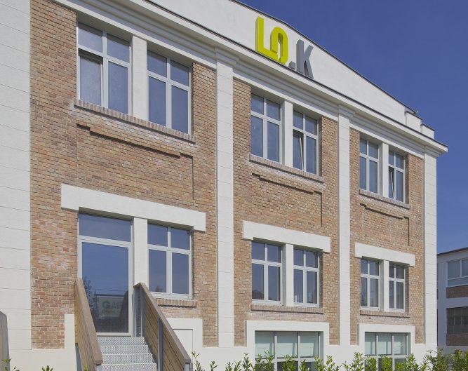 Umbau Ehemalige Modellbahnfabrik – Sanierte Backsteinfassade