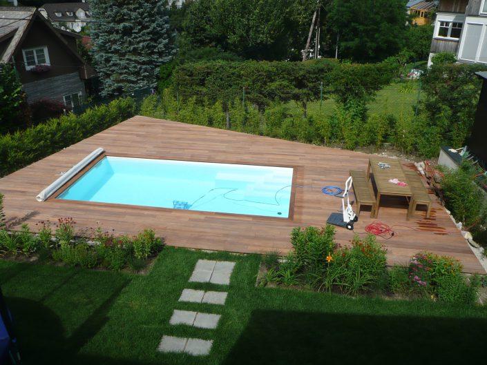 Errichtung gekuppeltes Kleingartenhaus – Garten mit Pool